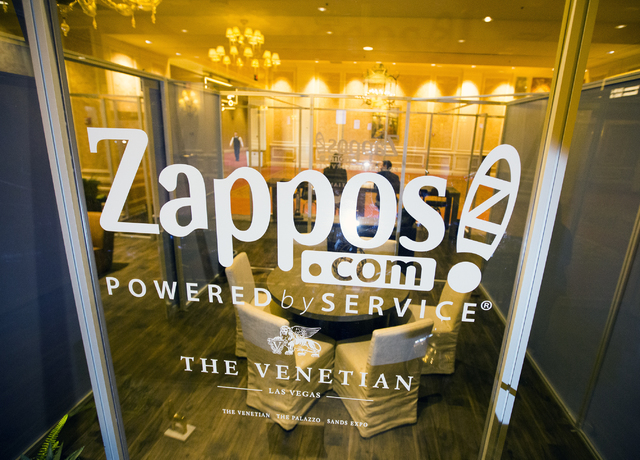 The Zappos-branded CoWorking Lounge in a corridor leading to the Sands Expo Center provides seating a charging units for guests. (Jeff Scheid/Las Vegas Review-Journal) @jeffscheid