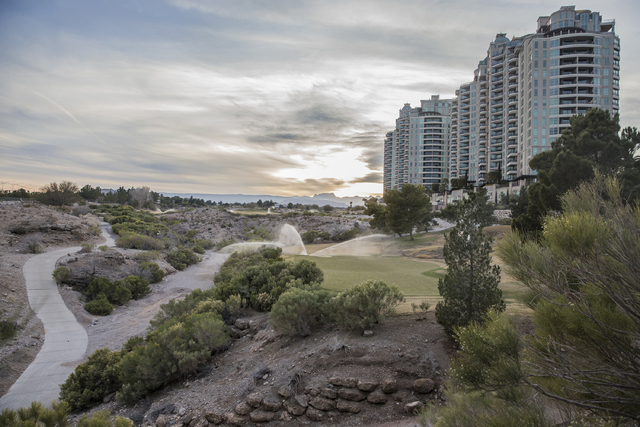 The Badlands golf course is watered at dusk on Wednesday, Feb. 1, 2017, in Las Vegas. The proposed development has prompted a more than year-long fight between the developer and neighboring reside ...