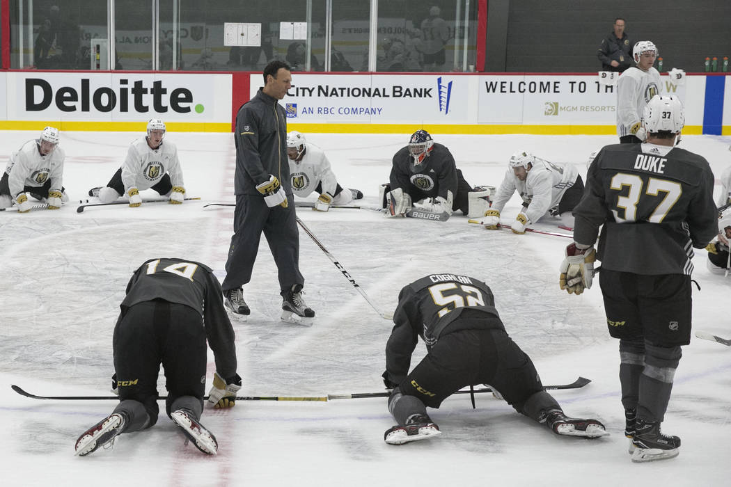Vegas Golden Knights' forward Reid Duke (37) listens to the Chicago Wolfs' coach Rocky Thompson, center, during rookie camp at City National Arena on Friday, Sept. 8, 2017, in Las Vegas. (Bizuayeh ...