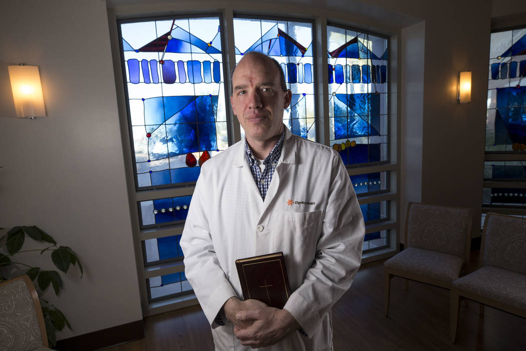 Father Ian Burgess, the chaplain at St. Rose Dominican Hospital Siena Campus, poses at the hospital's chapel, Thursday, Dec. 7, 2017, in Henderson. Richard Brian Las Vegas Review-Journal @vegaspho ...