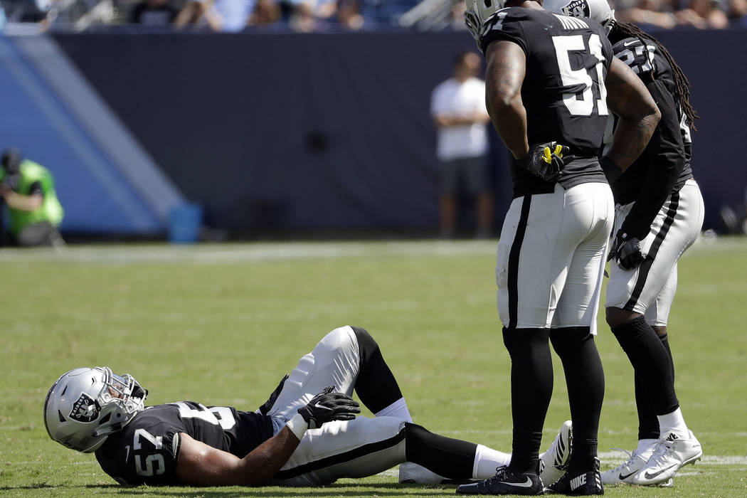 Oakland Raiders middle linebacker Cory James (57) lies on the turf after being injured in the second half of an NFL football game against the Tennessee Titans Sunday, Sept. 10, 2017, in Nashville, ...