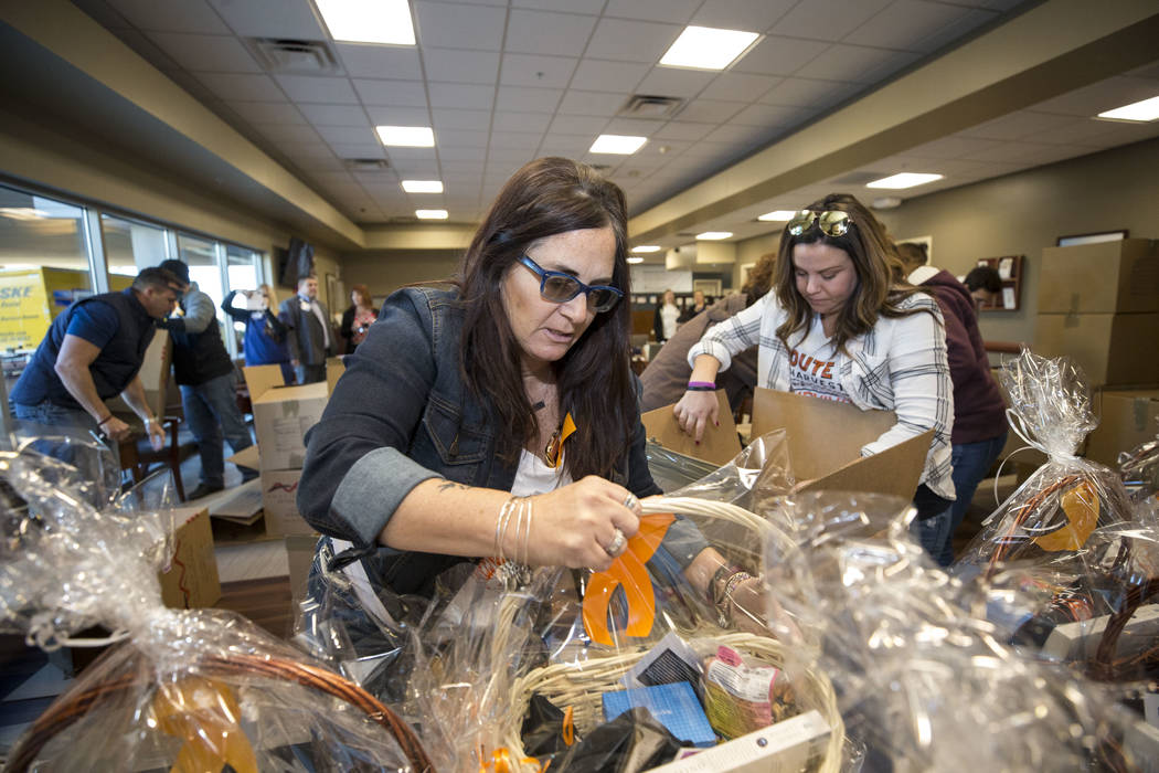 Route 91 Harvest festival survivors Angel Cortum, left, and Christy Antonio set up thank you baskets on a table intended for Spring Valley Hospital workers during a visit to the hospital's emergen ...