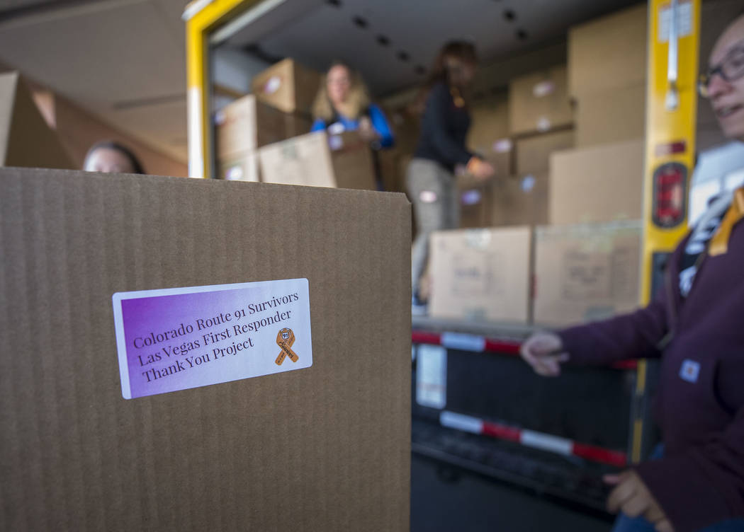 Route 91 Harvest festival survivors and volunteers unload boxes containing thank you baskets intended for Spring Valley Hospital workers during a visit the hospital's emergency room on Friday, Dec ...