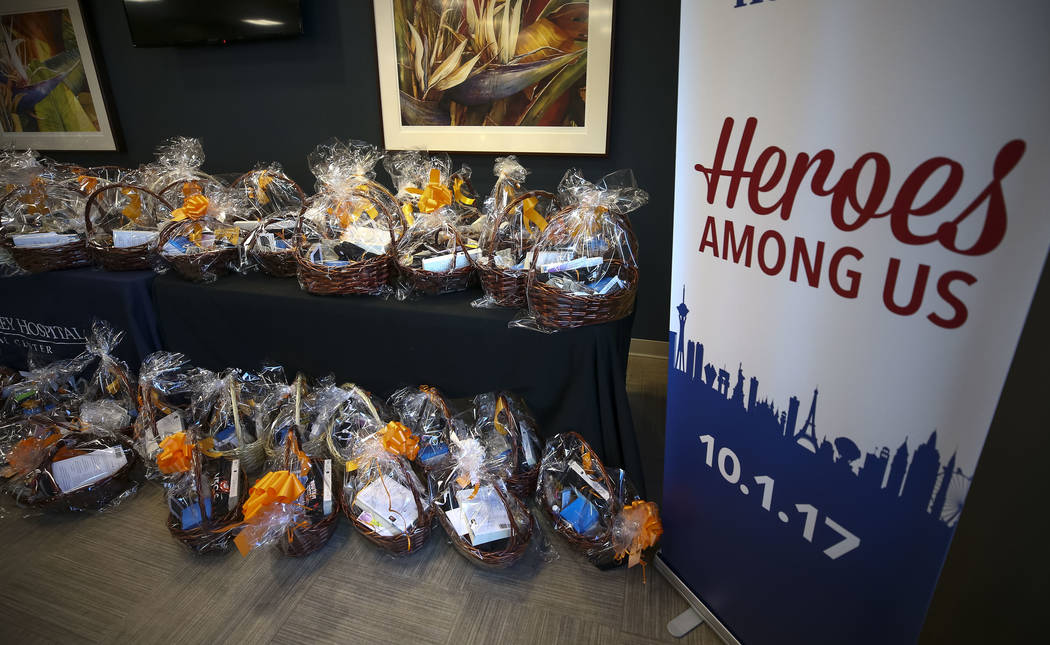 Seventy-five thank you baskets intended for Spring Valley Hospital workers wait on a table at the hospital's emergency room on Friday, Dec. 8, 2017. A group of Route 91 survivors delivered thank y ...