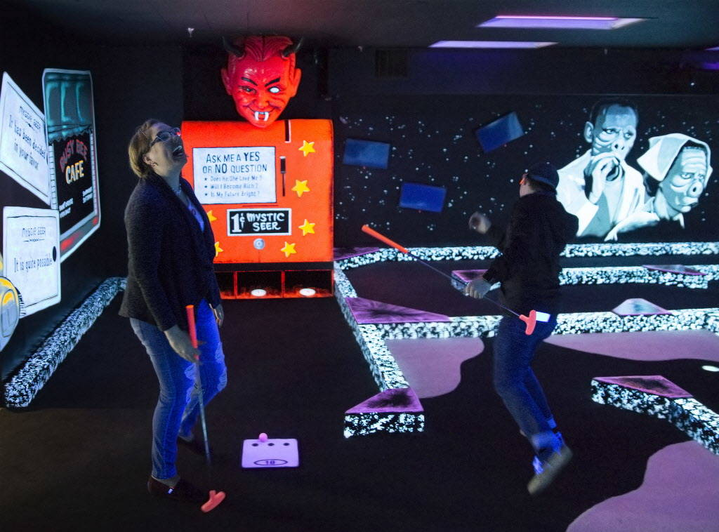 """Rebecca Hahn, left, celebrates with Patrick Deloriea on the 18th hole of """"The Twilight Zone by Monster Mini Golf"""" on Wednesday, Dec. 6, 2017, at Bally's hotel-casino, in Las Vega ..."""