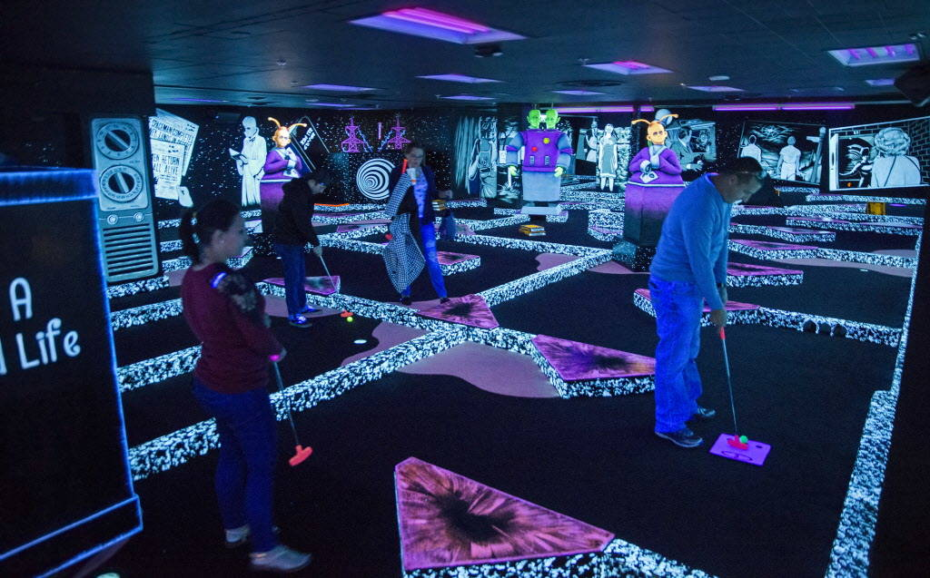"""Golfers play """"The Twilight Zone by Monster Mini Golf"""" on Wednesday, Dec. 6, 2017, at Bally's hotel-casino, in Las Vegas. Benjamin Hager Las Vegas Review-Journal @benjaminhphoto"""