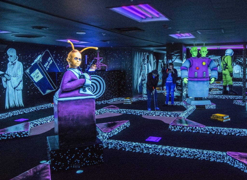 """Patrick Deloriea, middle, and Rebecca Hahn play """"The Twilight Zone by Monster Mini Golf"""" on Wednesday, Dec. 6, 2017, at Bally's hotel-casino, in Las Vegas. Benjamin Hager Las Veg ..."""