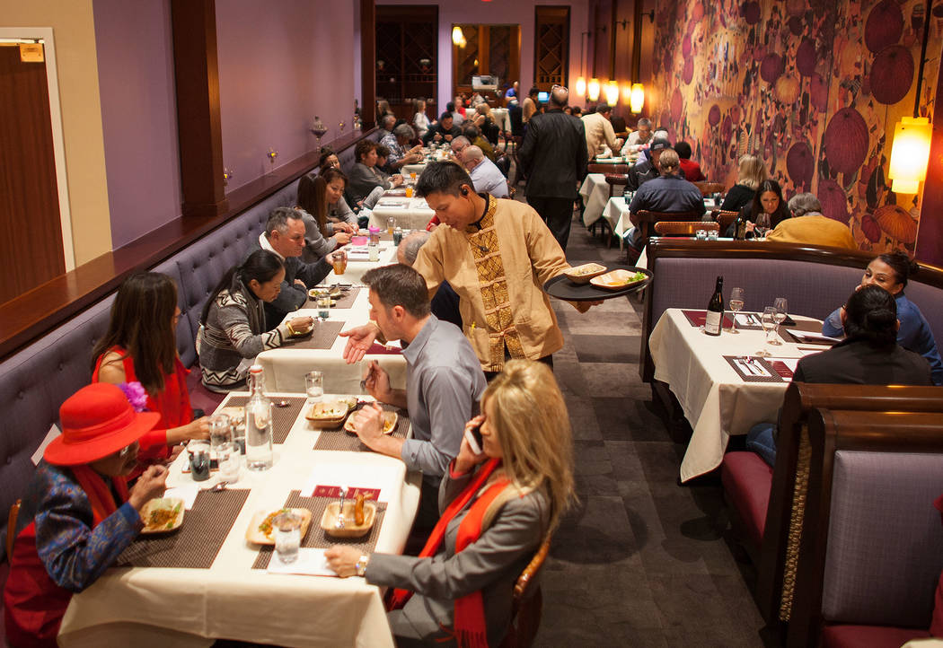 Guests eat in the dinning room at the new second location of Lotus of Siam, a thai restaurant, in Las Vegas, Sunday, Dec. 10, 2017. The restaurant held a birthday party for Chef Saipin Chutima tha ...