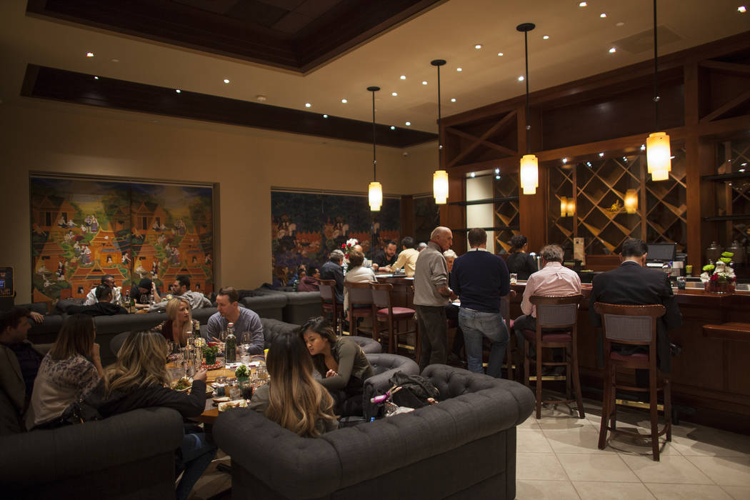 Guests eat in the bar and lounge area at the new second location of Lotus of Siam, a thai restaurant, in Las Vegas, Sunday, Dec. 10, 2017. The restaurant held a birthday party for Chef Saipin Chut ...