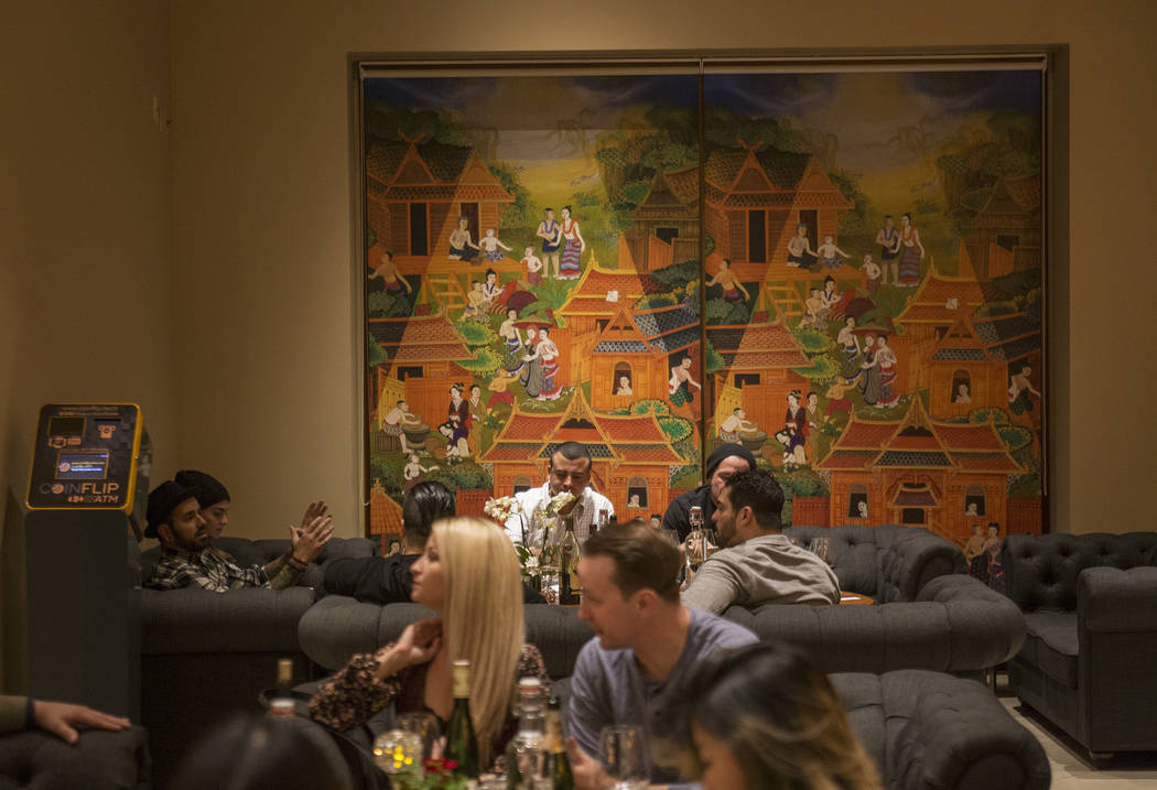 Guests eat in the lounge and bar area at the new second location of Lotus of Siam, a thai restaurant, in Las Vegas, Sunday, Dec. 10, 2017. The restaurant held a birthday party for Chef Saipin Chut ...