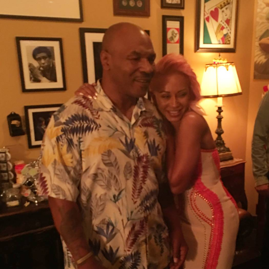 """Mike Tyson meets up with Mel B. after """"Undisputed Truth: Round 2"""" at Brad Garrett's Comedy Club at MGM Grand on Monday, Nov. 20, 2017."""