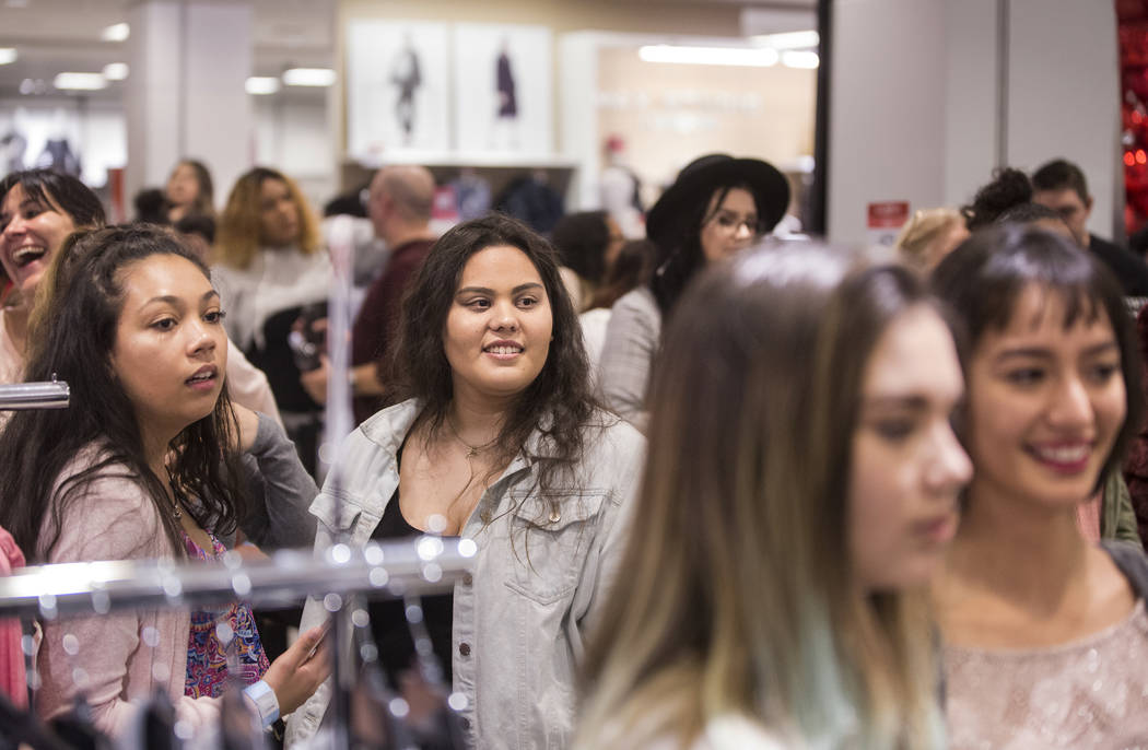 Attendees wait to meet model and designer Ashley Graham during an event to celebrate the release of Graham's holiday collection of lingerie at Macy's Fashion Show on Wednesday, Nov. 29, 2017, in L ...