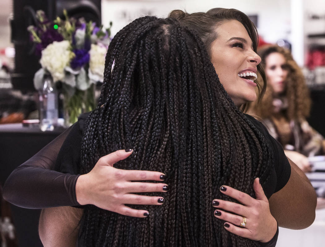 Model and designer Ashley Graham hugs a fan during a meet and greet to celebrate the release of Graham's holiday collection of lingerie at Macy's Fashion Show on Wednesday, Nov. 29, 2017, in Las V ...