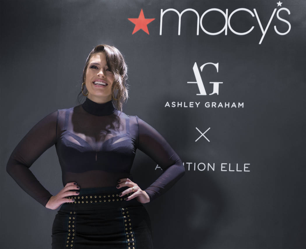 Model and designer Ashley Graham takes photos  during a meet and greet to celebrate the release of Graham's holiday collection of lingerie at Macy's Fashion Show on Wednesday, Nov. 29, 2017, in La ...