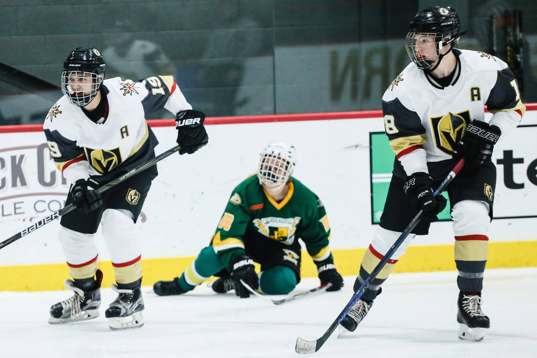 Vegas Jr. Golden Knights' Danny Ramos (19), left, Edison Chargers' Evan Osterkamp (88), center, and Vegas Jr. Golden Knights' Patrick Voors (18), right, chase after the  puck during the third peri ...
