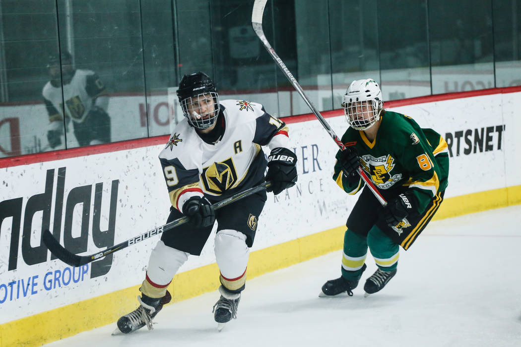 Vegas Jr. Golden Knights' Danny Ramos (19), left, and Edison Chargers' Evan Osterkamp (88), right, chase after the puck during the third period of a hockey game at City National Arena in Las Vegas ...