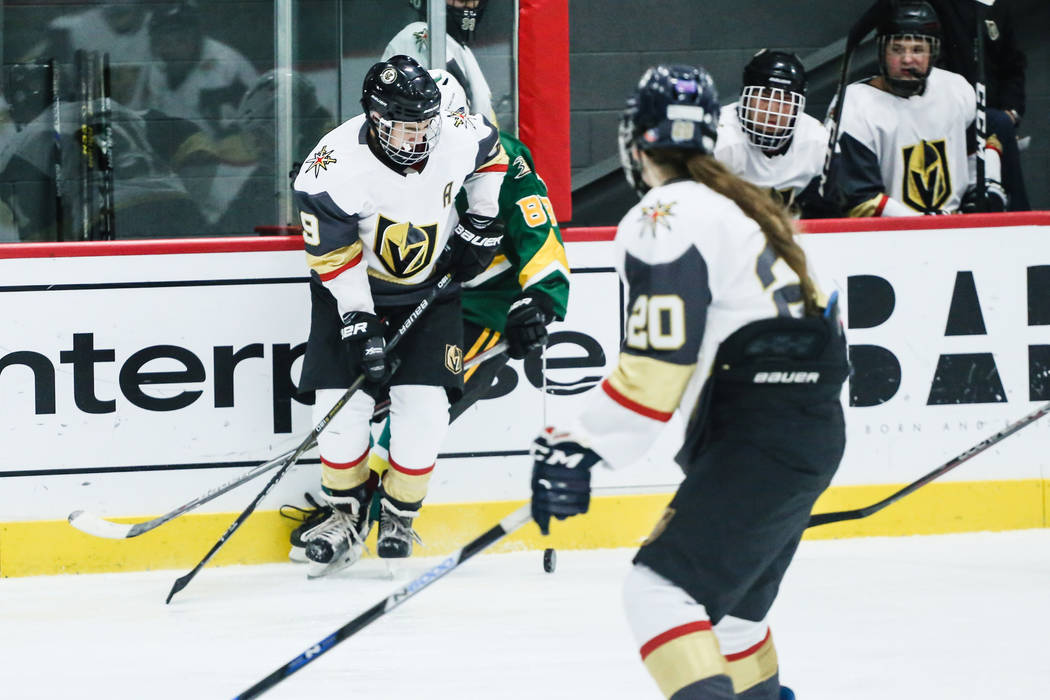 Vegas Jr. Golden Knights' Danny Ramos (19), left, and Edison Chargers' Evan Osterkamp (88), center, chase after the puck as Vegas Jr. Golden Knights' Emily Kline (20), right, watches during the th ...
