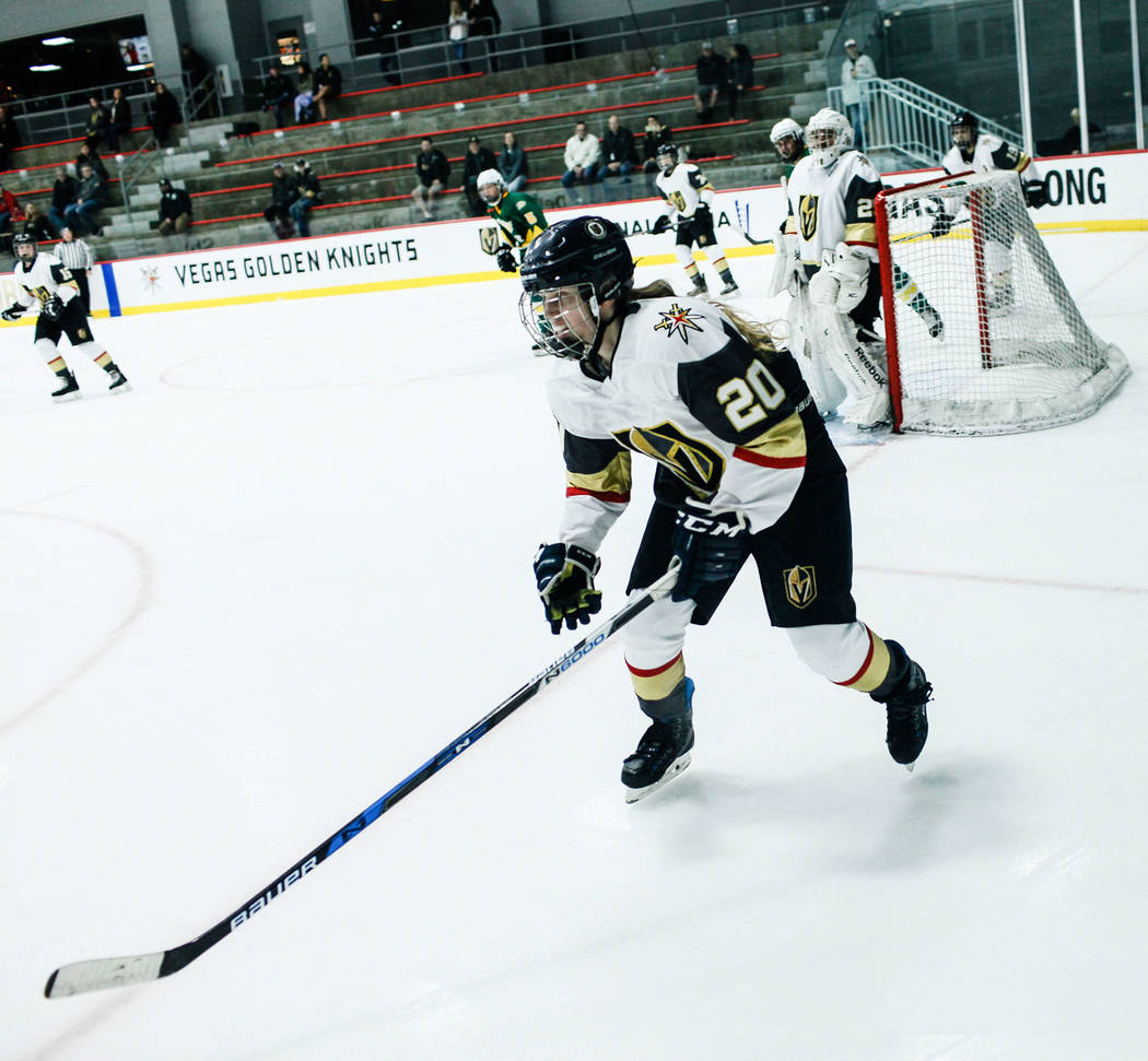 Vegas Jr. Golden Knights' Emily Kline (20) chases after the puck during the third period of a hockey game against the Edison Chargers at City National Arena in Las Vegas, Friday, Dec. 8, 2017. Edi ...