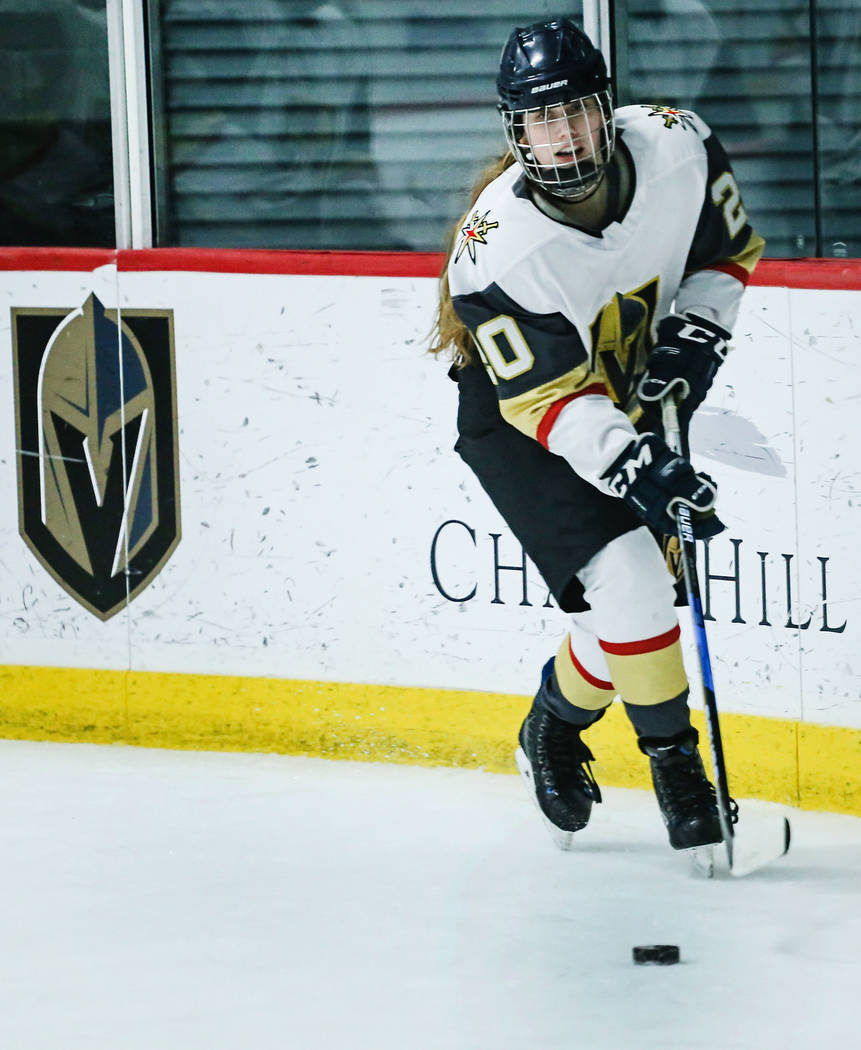 Vegas Jr. Golden Knights' Emily Kline (20) moves the puck during the third period of a hockey game against the Edison Chargers at City National Arena in Las Vegas, Friday, Dec. 8, 2017. Edison Cha ...