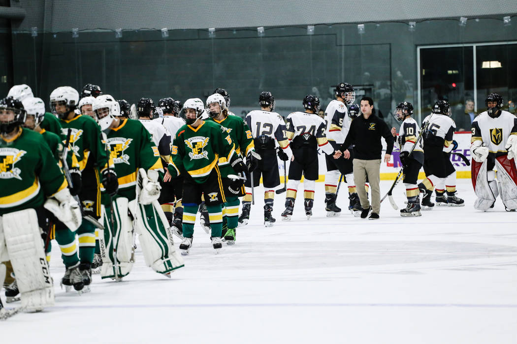 Edison Chargers and Vegas Jr. Golden Knights shake hands at the end of a hockey game at City National Arena in Las Vegas, Friday, Dec. 8, 2017. Edison Chargers won 7-4. Joel Angel Juarez Las Vegas ...