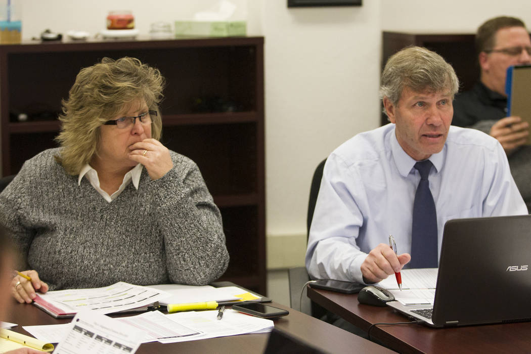 Pamela Sloan, left, director of athletics for the Clark County School District, and Bart Thompson, executive director for the NIAA, during a Nevada Interscholastic Activities Association realignme ...