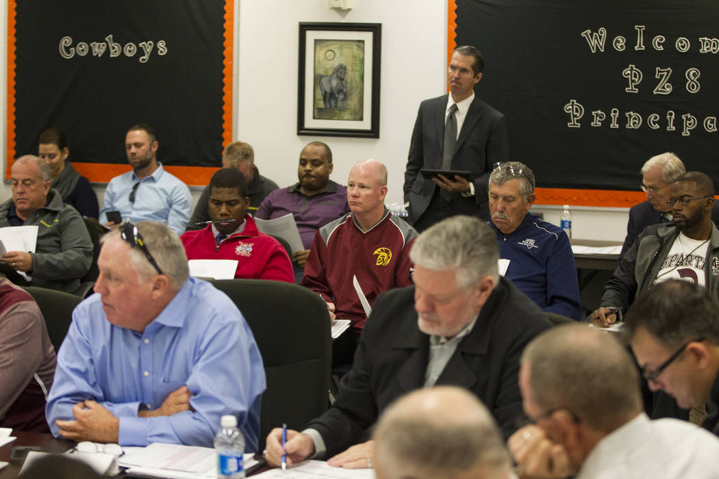 Clark County School District coach and administrators during a Nevada Interscholastic Activities Association realignment committee meeting at Chaparral High School in Las Vegas, Thursday, Dec. 7,  ...