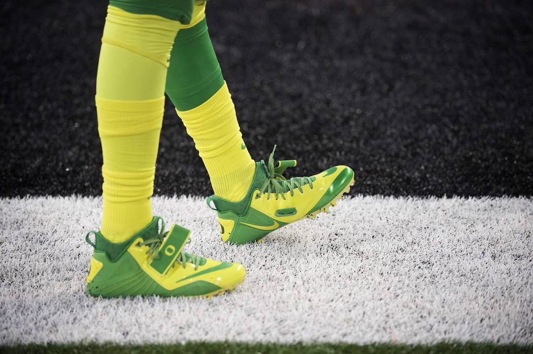 File - In this Nov. 15, 2014 file photo, an Oregon duck player warms up before an NCAA college football game against Oregon State in Corvallis, Ore. (AP Photo/Troy Wayrynen, File)