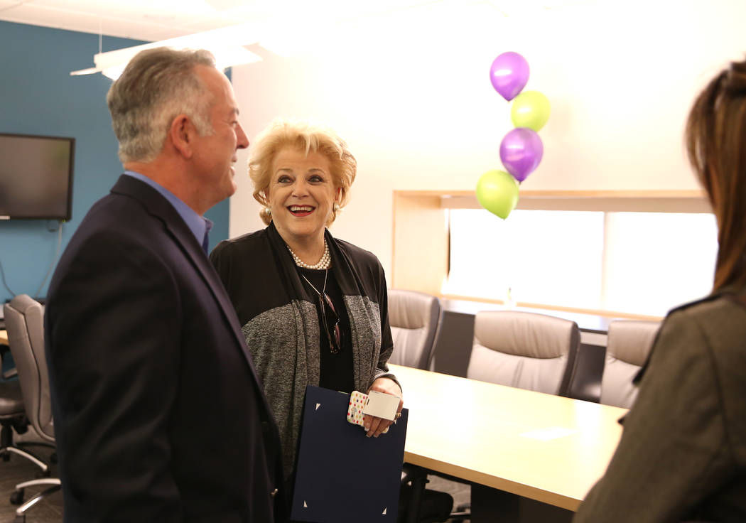 Sheriff Joseph Lombardo and Mayor Carolyn Goodman chat inside the group therapy room for batterers before the ribbon cutting ceremony for the opening of the new Safe Nest office and treatment cent ...