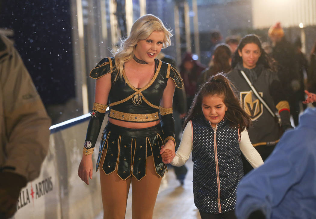 "Natallie Kowalski, left, of the Golden Knights ice crew, skates with 8-year-old Mya of Los Angeles during the ""Night With the Golden Knights"" event at the ice rink at The Cosmopo ..."
