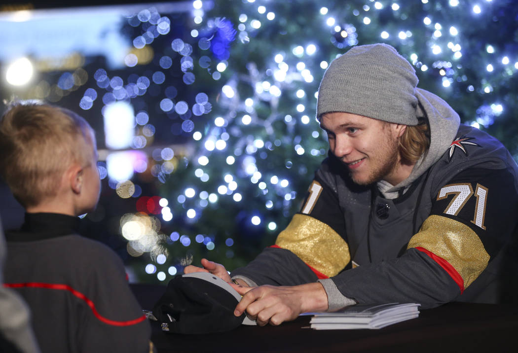 "Golden Knights' William Karlsson signs autographs during the ""Night With the Golden Knights"" event at the ice rink at The Cosmopolitan of Las Vegas in Las Vegas on Wednesday, Dec ..."