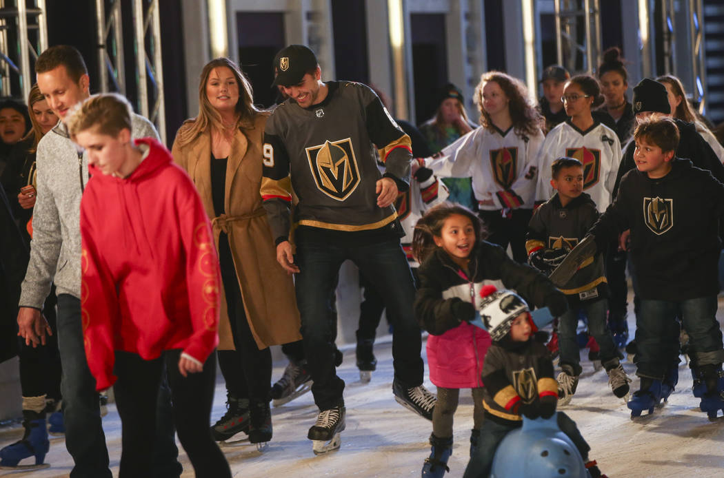 "Golden Knights' Alex Tuch, center left, skates with hockey fans during the ""Night With the Golden Knights"" event at the ice rink at The Cosmopolitan of Las Vegas in Las Vegas on  ..."