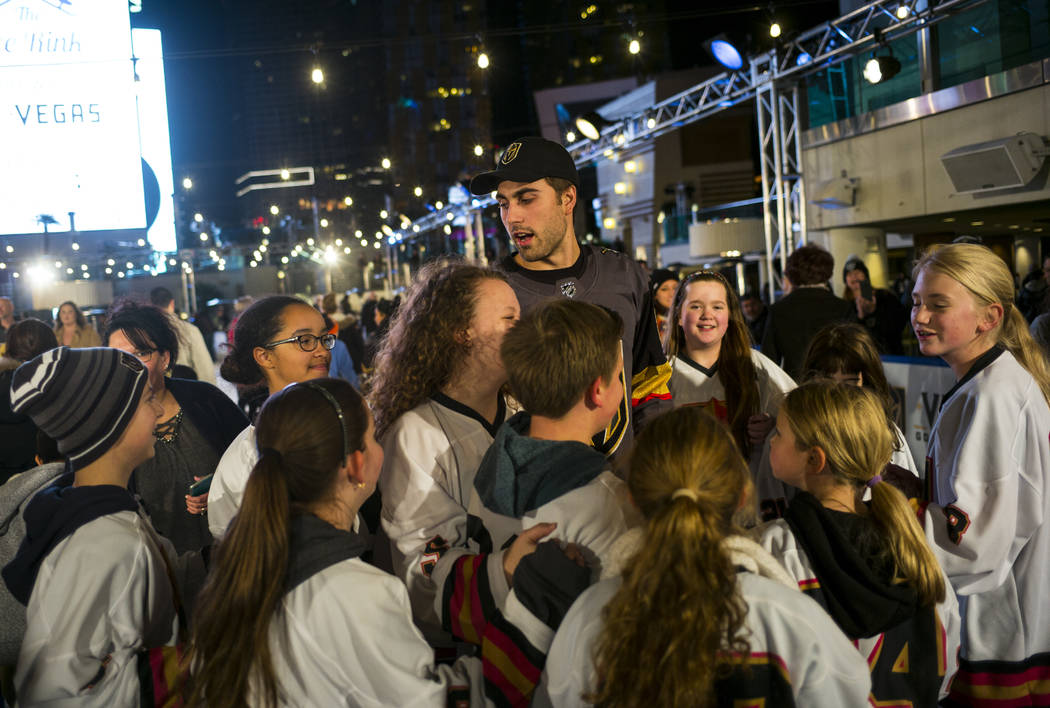 "Golden Knights' Alex Tuch, above, greets young hockey fans during the ""Night With the Golden Knights"" event at the ice rink at The Cosmopolitan of Las Vegas in Las Vegas on Wedne ..."