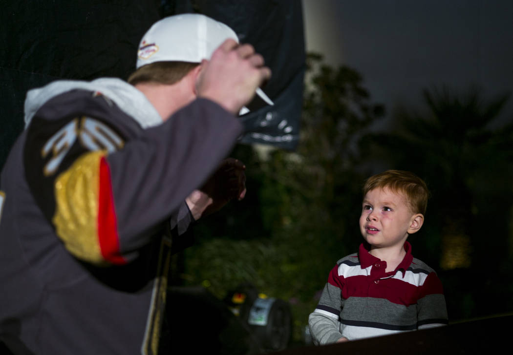 "Golden Knights' Oscar Dansk talks with 4-year-old River Ercanbrack during the ""Night With the Golden Knights"" event at the ice rink at The Cosmopolitan of Las Vegas in Las Vegas  ..."