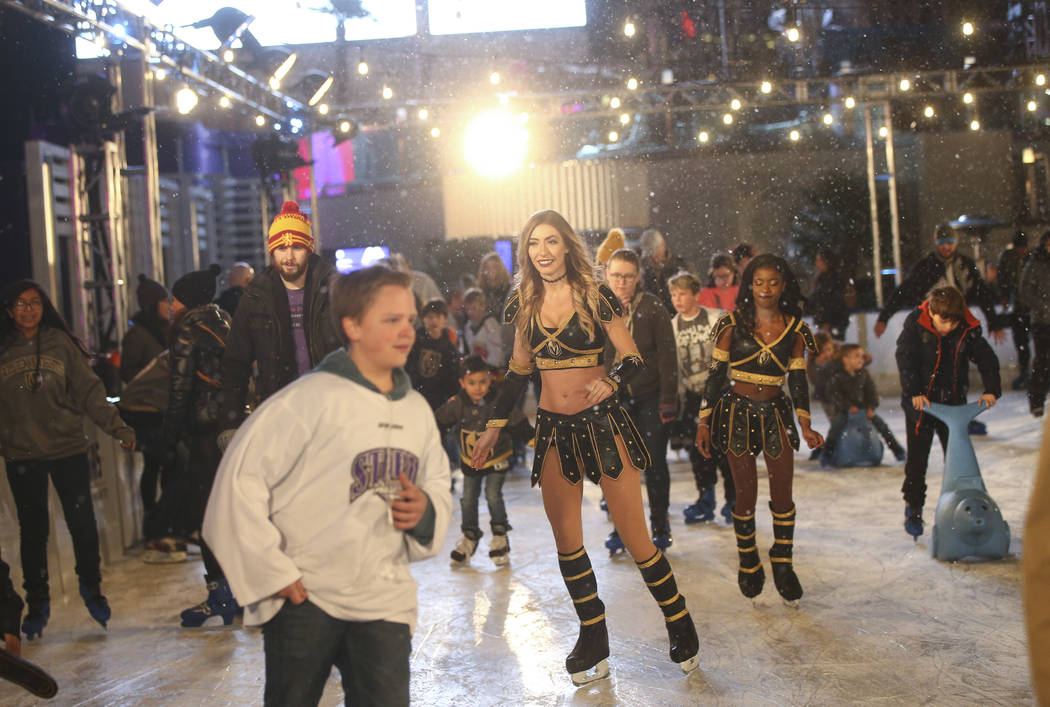 "Members of the Golden Knights ice crew join participants during the ""Night With the Golden Knights"" event at the ice rink at The Cosmopolitan of Las Vegas in Las Vegas on Wednesd ..."