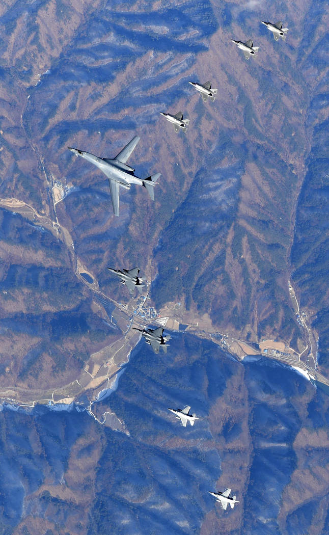 In this photo provided by South Korea Defense Ministry, U.S. Air Force B-1B bomber, center, flies over the Korean Peninsula with South Korean fighter jets F-16, F-15K and U.S. fighter jets F-35A,  ...