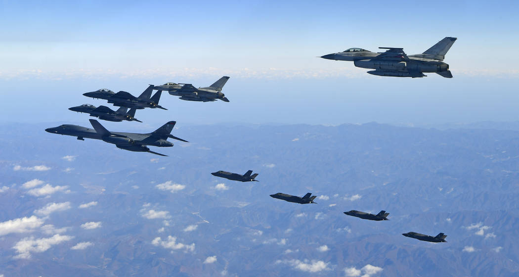 In this photo provided by South Korea Defense Ministry, U.S. Air Force B-1B bomber, far left, South Korea and U.S. fighter jets fly over the Korean Peninsula during the combined aerial exercise, S ...
