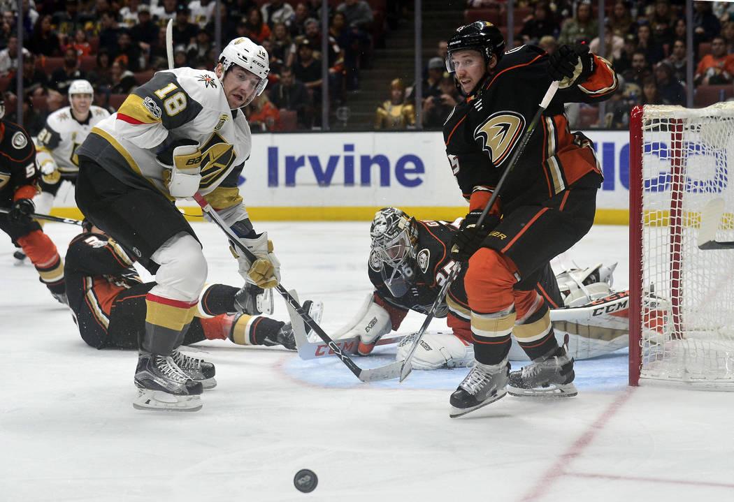 November 22, 2017; Anaheim, CA, USA; /Anaheim Ducks defenseman Sami Vatanen (45) helps goalie John Gibson (36) defend the goal as Vegas Golden Knights left wing James Neal (18) moves in for a shot ...