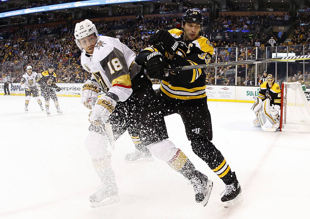 Boston Bruins' Zdeno Chara, right, collides withe Vegas Golden Knights' James Neal (18) during the first period of an NHL hockey game in Boston, Thursday, Nov. 2, 2017. (AP Photo/Winslow Townson)