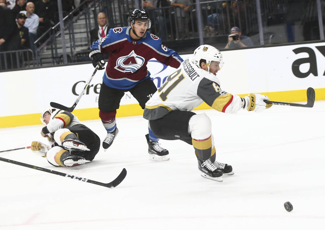 Golden Knights' James Neal (18), left, gets tripped up as Golden Knights' Jonathan Marchessault (81) skates by during an NHL hockey game against the Colorado Avalanche at T-Mobile Arena in Las Veg ...