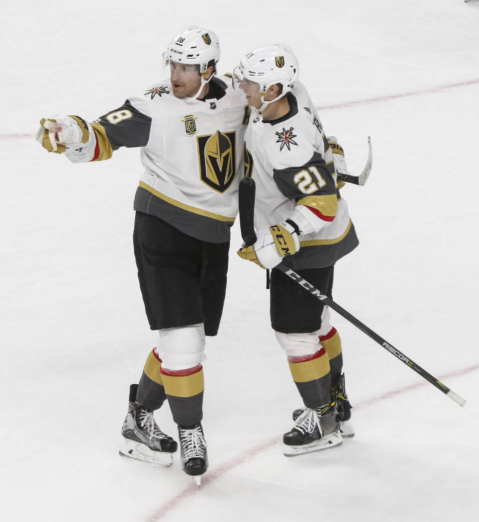 Golden Knights' James Neal (18) celebrates his goal with Cody Eakin (21) during an NHL hockey game against the Colorado Avalanche at T-Mobile Arena in Las Vegas on Friday, Oct. 27, 2017. Chase Ste ...