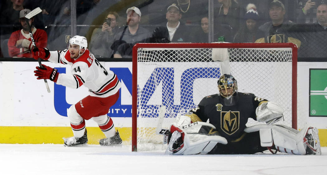 Carolina Hurricanes left wing Phil Di Giuseppe reacts after scoring on Vegas Golden Knights goalie Marc-Andre Fleury during a shootout to win an NHL hockey game 3-2 Tuesday, Dec. 12, 2017, in Las  ...