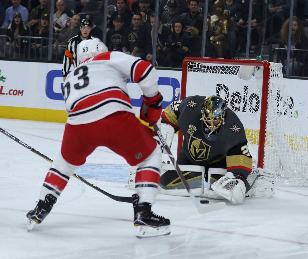 Vegas Golden Knights goalie Marc-Andre Fleury (29) makes a save after Carolina Hurricanes left wing Jeff Skinner (53) shoots during the first period of a NHL game in Las Vegas, Tuesday, Dec. 12, 2 ...