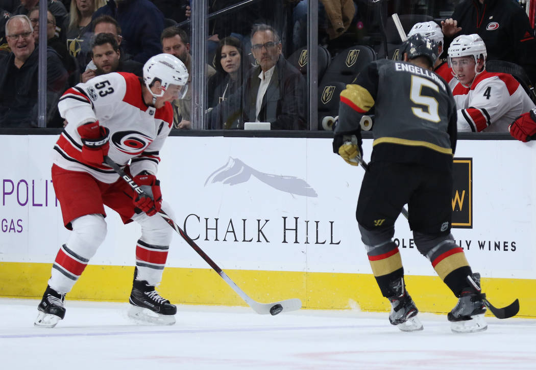 Carolina Hurricanes left wing Jeff Skinner (53) handles the puck as Vegas Golden Knights defenseman Deryk Engelland (5) pursues him during the first period of a NHL game in Las Vegas, Tuesday, Dec ...