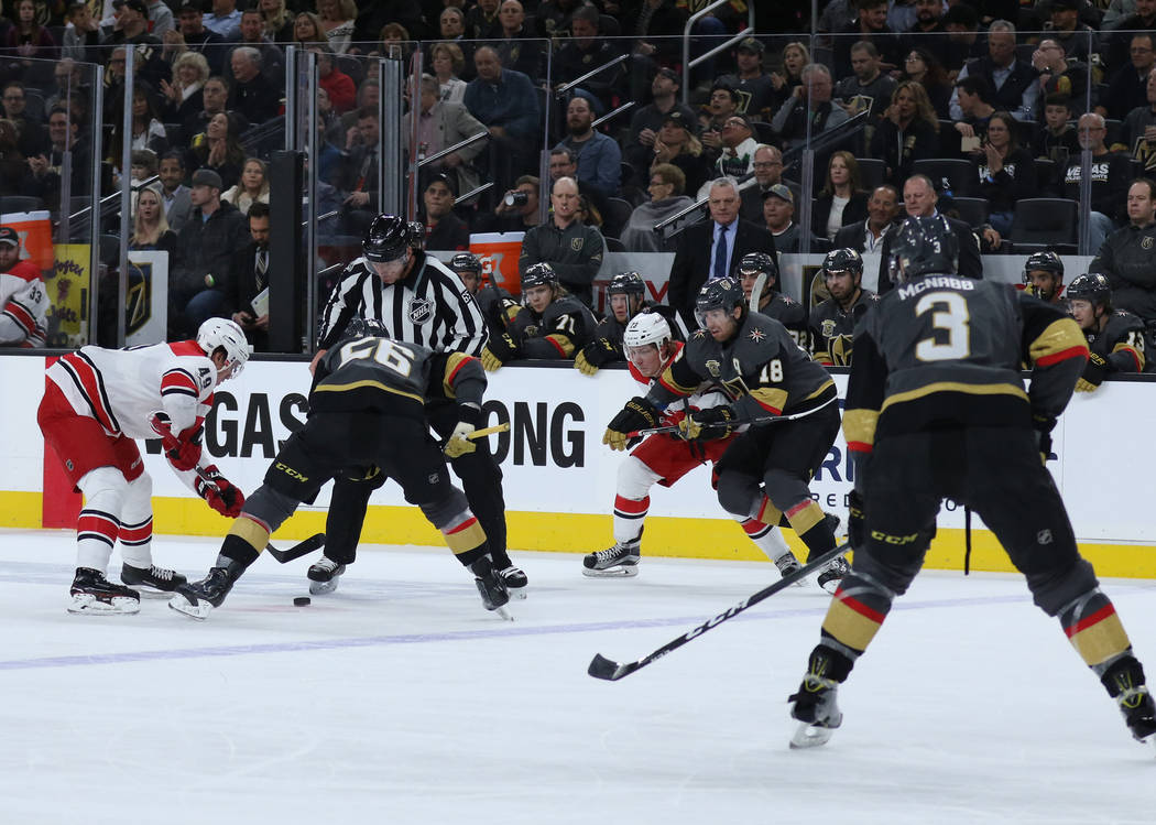 Vegas Golden Knights left wing Erik Haula (56) and Carolina Hurricanes center Victor Rask (49) face-off during the first period of a NHL game in Las Vegas, Tuesday, Dec. 12, 2017. Heidi Fang Las V ...
