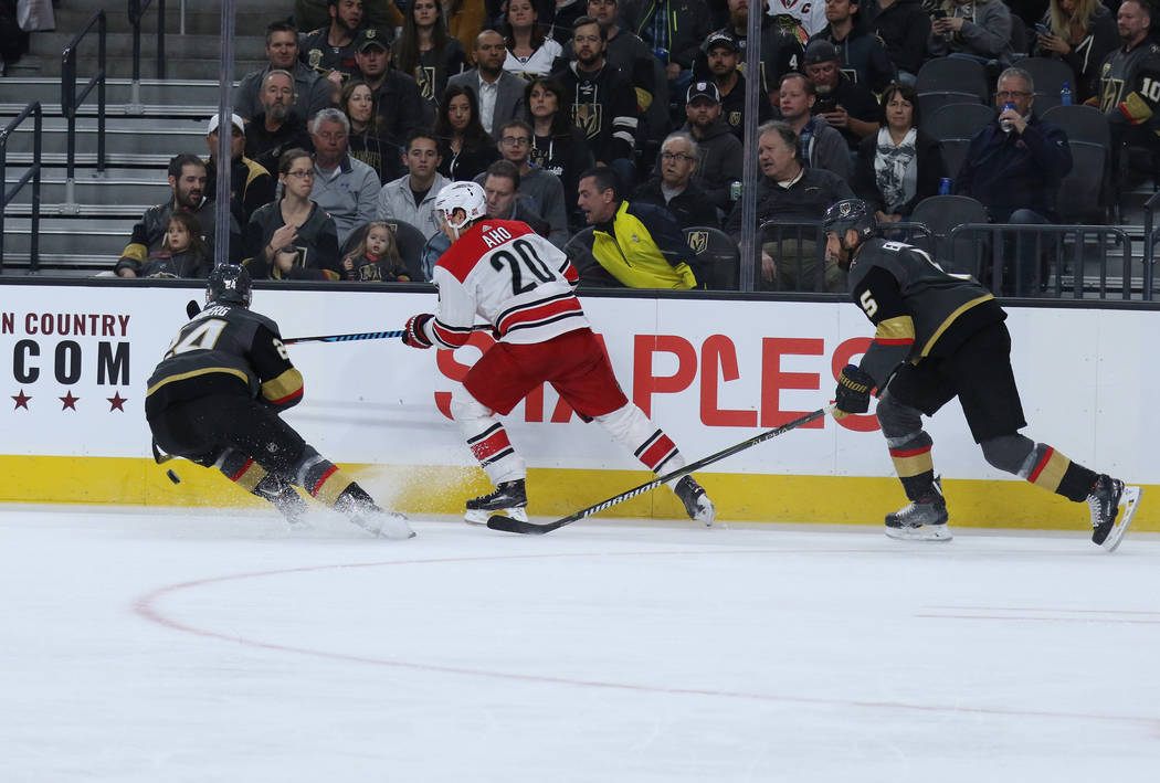 Vegas Golden Knights center Oscar Lindberg (24) skates towards the puck as Carolina Hurricanes right wing Sebastian Aho (20) and defenseman Deryk Engelland (5) skate toward the action during the f ...