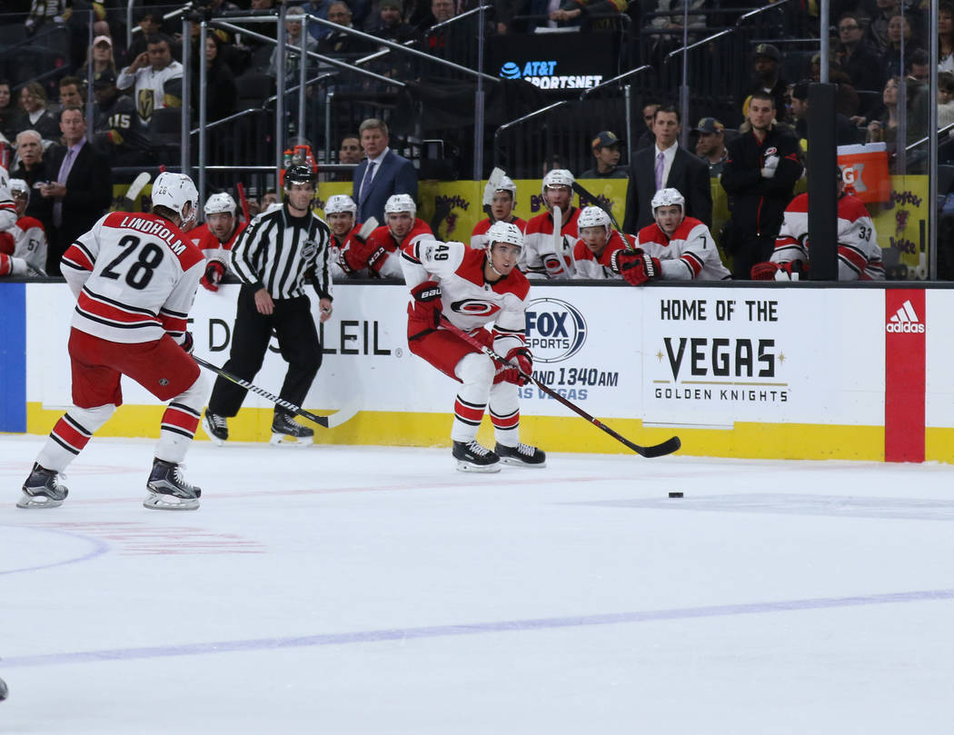 Carolina Hurricanes center Victor Rask (49) skates towards the Vegas Golden Knights goal as center Elias Lindholm (28) follows him during the first period of a NHL game in Las Vegas, Tuesday, Dec. ...