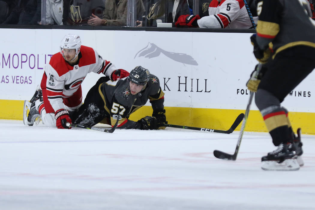 Vegas Golden Knights left wing David Perron (57) and Carolina Hurricanes center Marcus Kruger (16) fall on the ice during the first period of a NHL game in Las Vegas, Tuesday, Dec. 12, 2017. Heidi ...