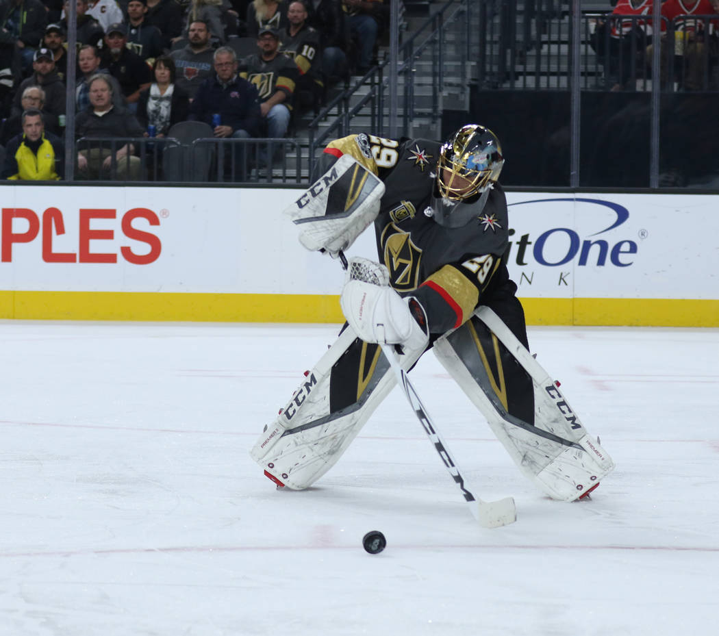 Vegas Golden Knights goalie Marc-Andre Fleury (29) handles the puck during the first period of a NHL game against the Carolina Hurricanes in Las Vegas, Tuesday, Dec. 12, 2017. Heidi Fang Las Vegas ...