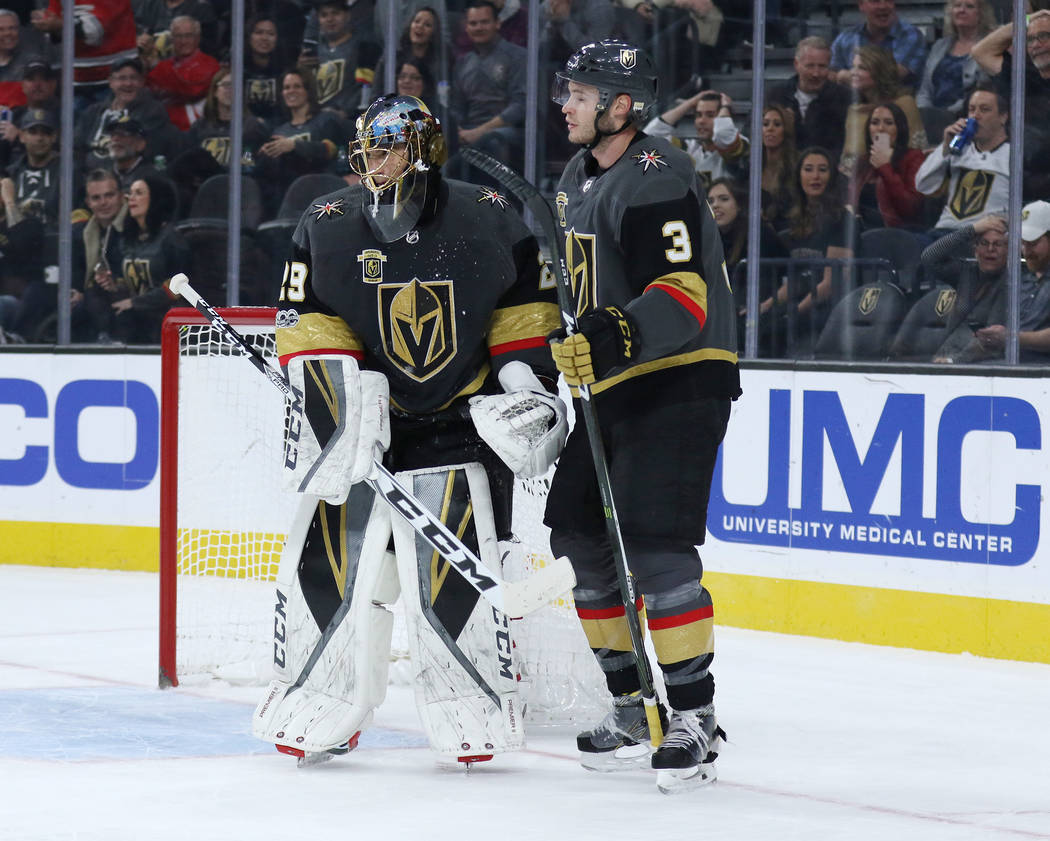 Vegas Golden Knights goalie Marc-Andre Fleury (29) and defenseman Brayden McNabb (3) talk on the ice after a goal is scored by the Carolina Hurricanes during the first period of a NHL game in Las  ...