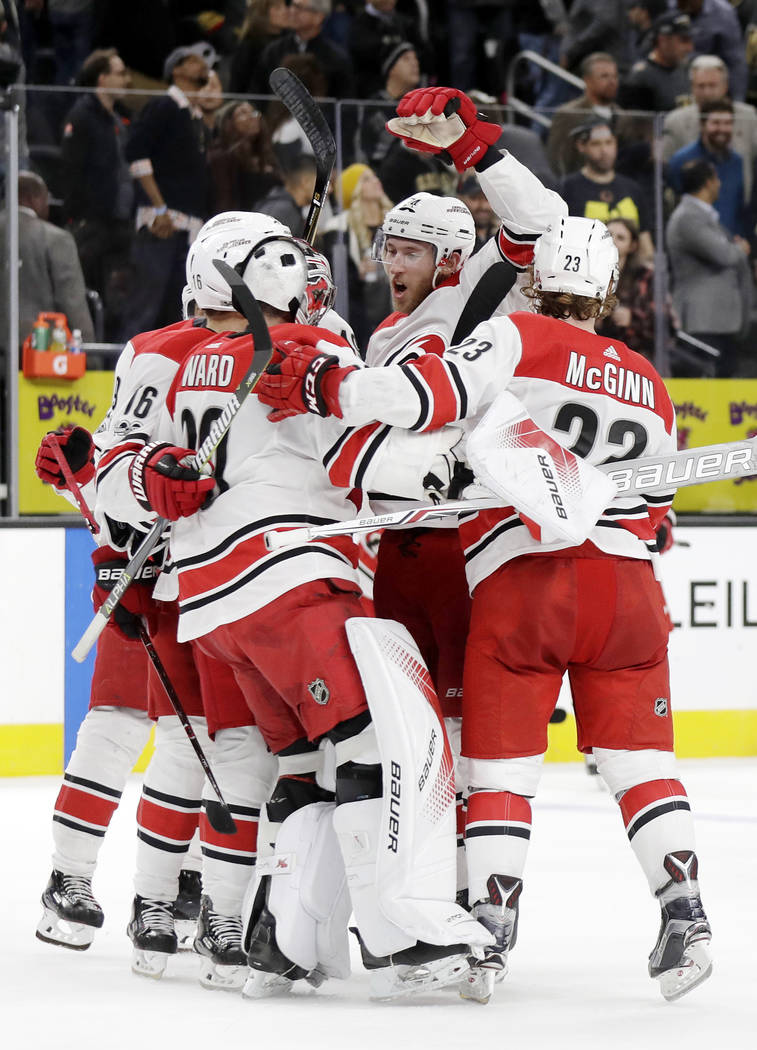 Carolina Hurricanes celebrate after defeating the Vegas Golden Knights following a shootout during an NHL hockey game Tuesday, Dec. 12, 2017, in Las Vegas. (AP Photo/Isaac Brekken)